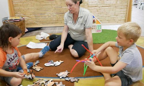 Kids and Teacher playing puzzle - Okinja ELC Maroochydore